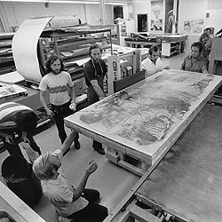 Robert Rauschenberg working with his printmakers on prints: http://nga.gov.au/InternationalPrints/Tyler/IMAGES/SUPS/166510.jpg