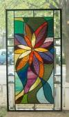 Asymmetrical Design in Stained Glass: https://i.pinimg.com/originals/d0/1e/9c/d01e9c16ea498ae05822086ca466a59e.jpg